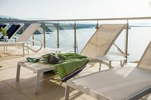 Relax on the sunloungers and enjoy the views along with the sun all day long