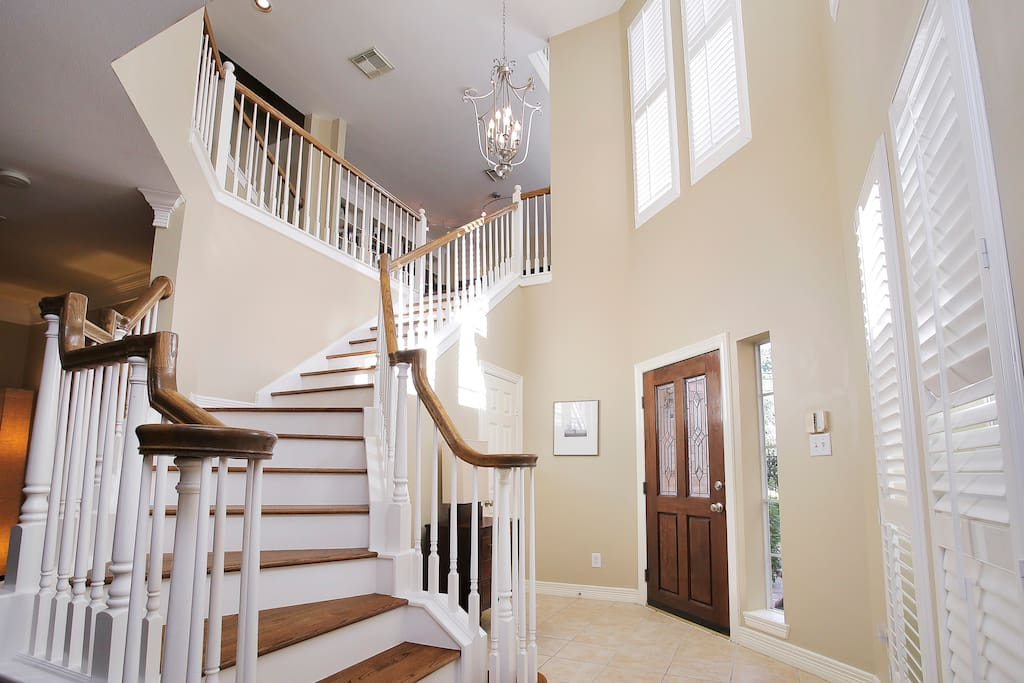 The three story foyer is open and grand.