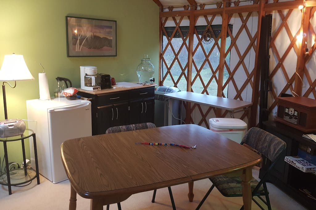 Kitchenette includes refrigerator, coffee maker, hot water pot, toaster, utensils and dishes, coffee, tea, and other amenities.