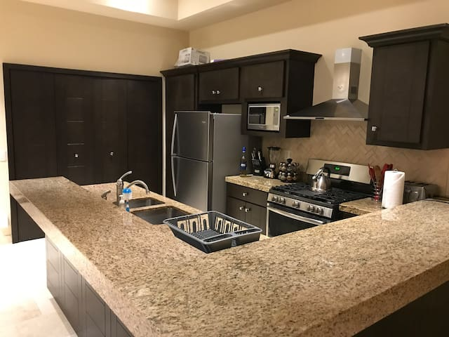 Kitchen has full amenities for all your cooking needs