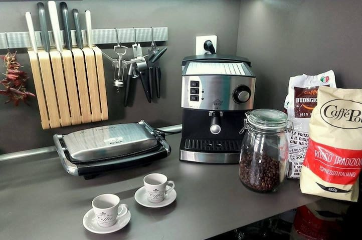 Italian espresso machine and the freshly grinded coffee...toaster and other standard kitchen equipment fully available