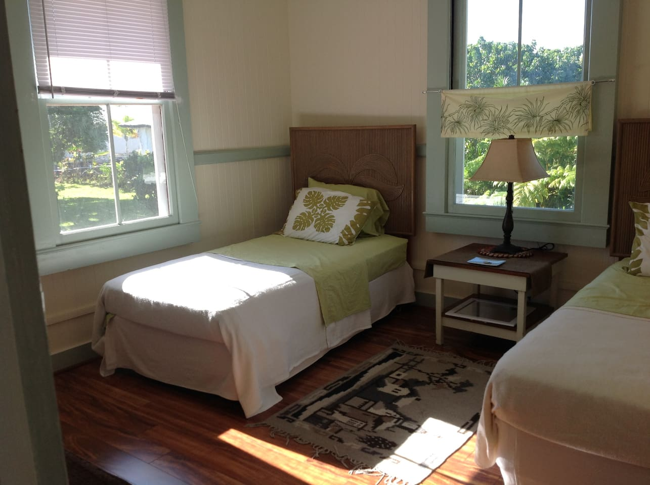 A twin beds with 2 big windows