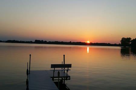 Lake house with beautiful sunsets!
