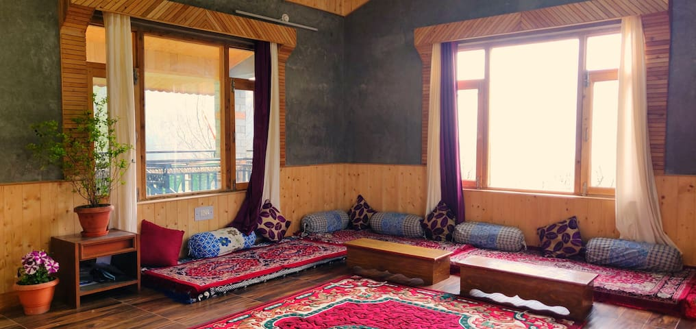 Living area is decked in traditional Himachali seating