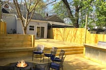 Epic backyard deck with firepit and BBQ. Truly amazing. And at night it lights up!
