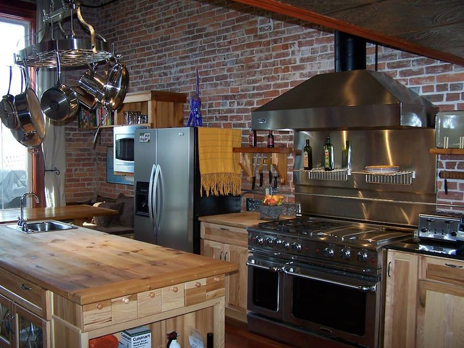 """Beautiful fully stocked chef's kitchen with 48"""" commercial range, indoor grill, flat-top, high end appliances"""