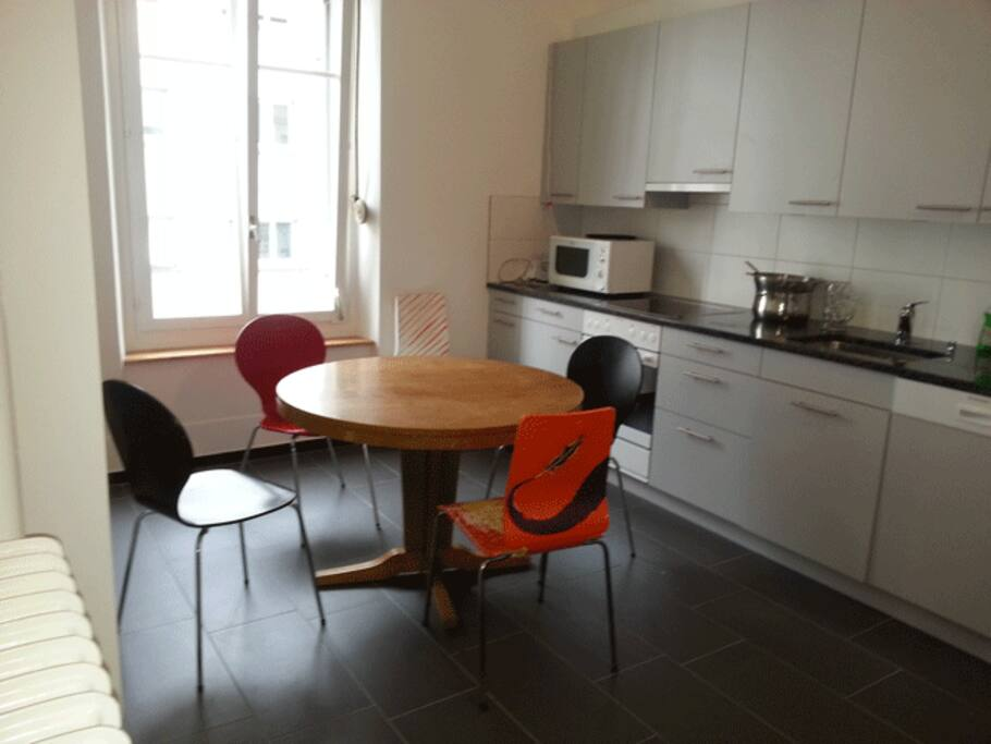 Big freshly renovated very well equipped kitchen with round table offering space for up to 8 people