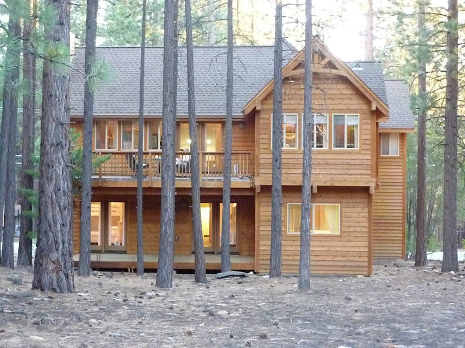 Rear of home with view of upper and lower decks