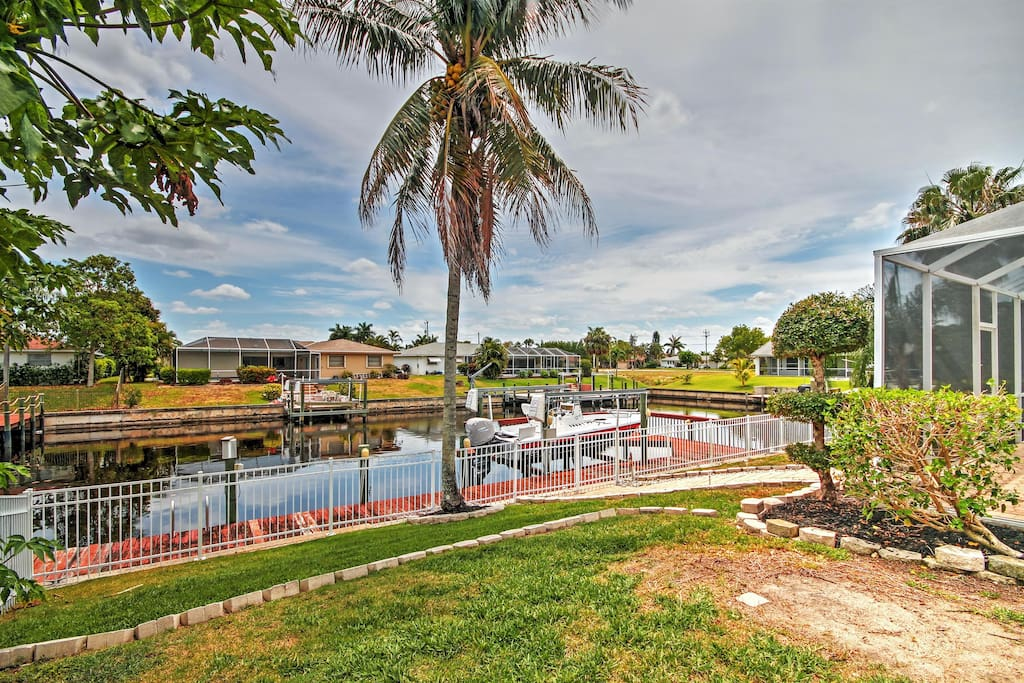 This Cape Coral home boasts a prime waterfront location w/ private 30-foot dock!