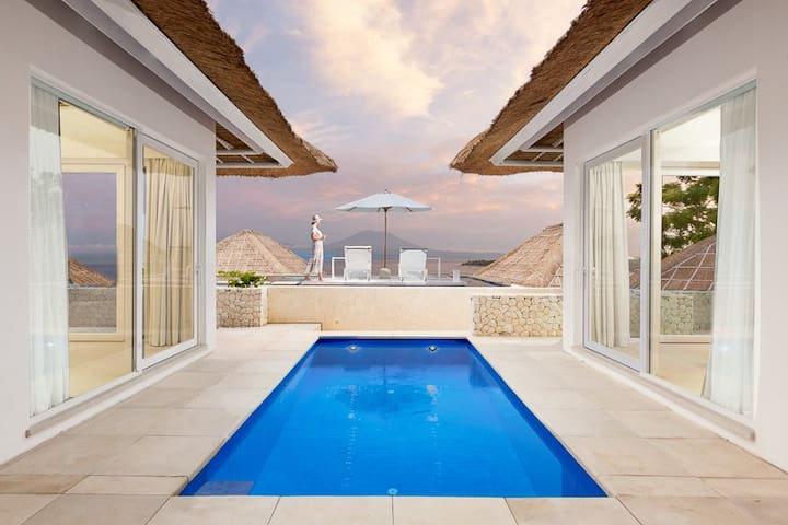 Nestled between two Deluxe Villas, the top level pool is just a step away from the relaxing sundeck - and that view!