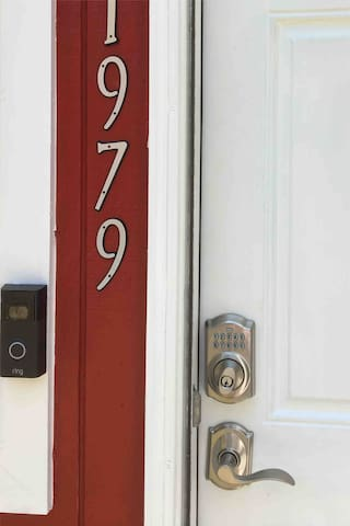 A key pad & a ring doorbell, with camera to ensure easy access.