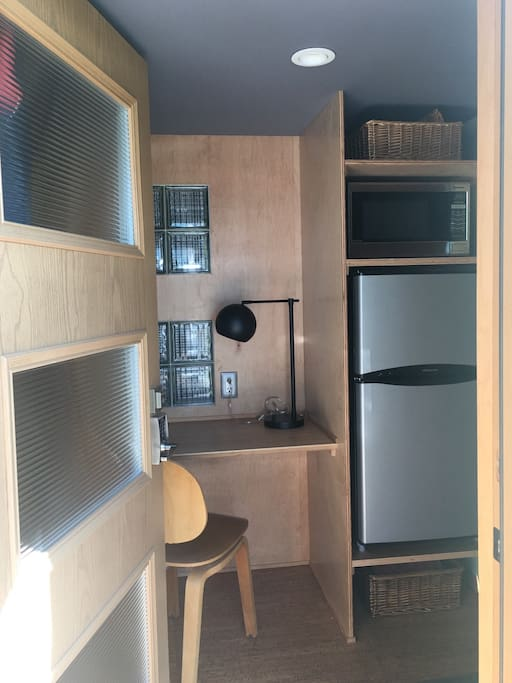 Your entry, with built in desk, plenty of hooks behind the door, fridge/freezer, microwave and extra storage.
