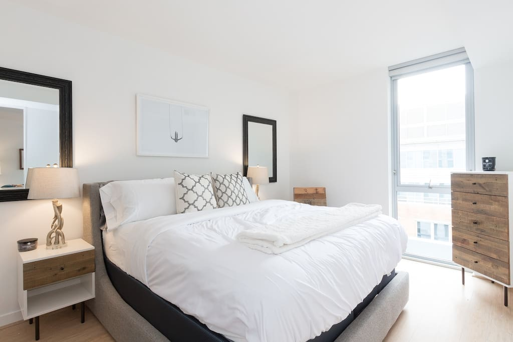 Master bedroom  is tastefully decorated with a king sized bed.  You will sleep very well.