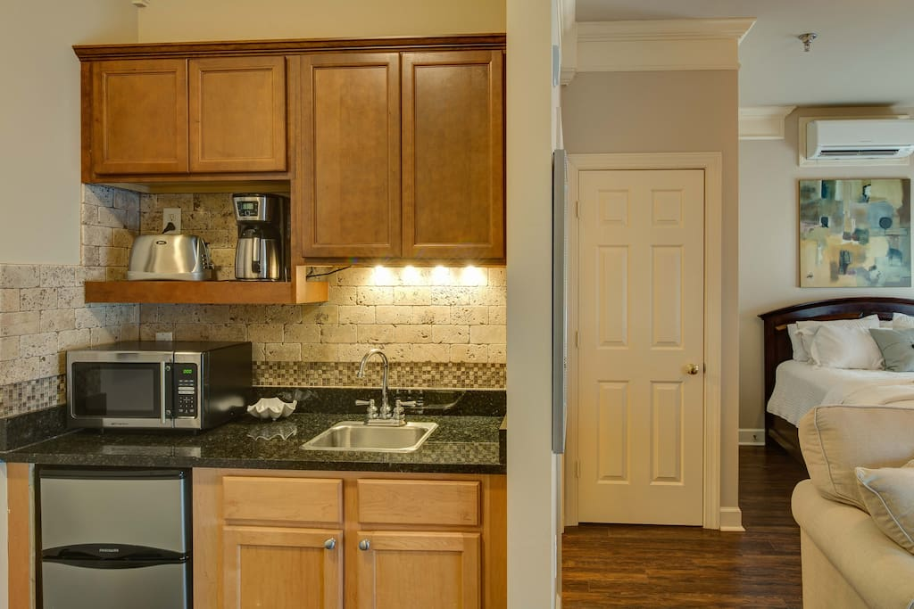 The convenient kitchenette is equipped with a mini-fridge and small appliances for coffee and toast.