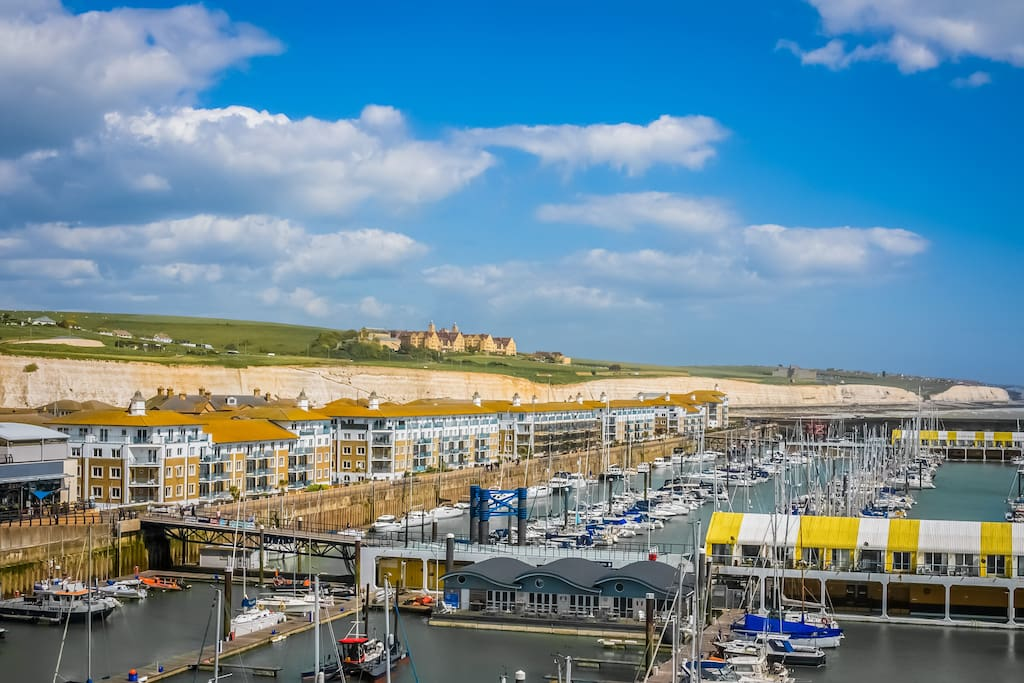 View from the balcony, across the marina with the white cliffs in the background