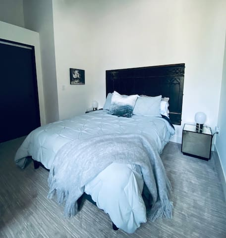 Guest bedroom with Queen size premium mattress.  Room darkening curtains with white noise maker and ample closet.