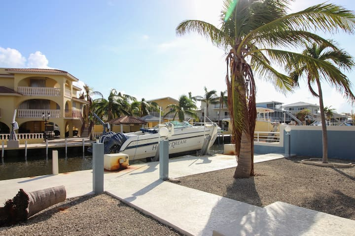 Canal-front, family-friendly home w/ soaking tub, dock access & water view!