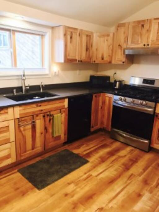 Kitchen has hickory cabinets, quartzite counter top, instant hot water, gas stove, dishwasher, etc.