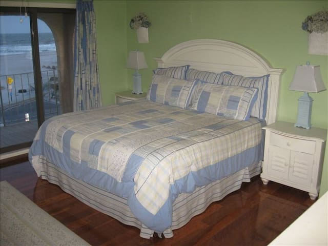 """Master Bedroom with King size bed and endless ocean views and 40"""" flat screen TV."""