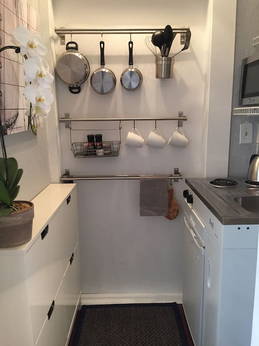 """The Galley"" - Kitchenette with cooktop, mini fridge, microwave and coffee maker."