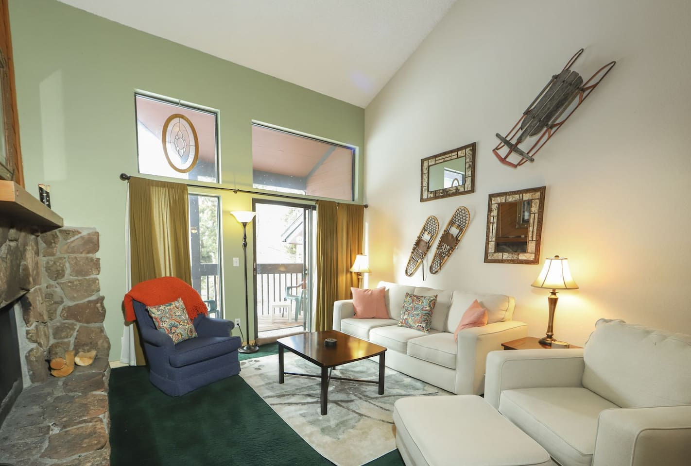 Winter Park area Family vacation rental. The living room with a confy couch, and chairs. The woodburning fireplace is also located in the living room.