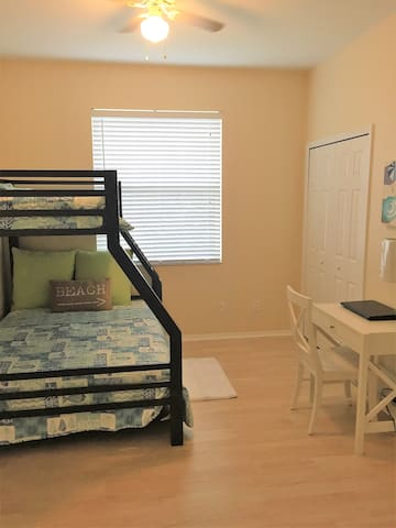 Guest bedroom #1 sleeps 3 full size on bottom, twin up top, desk, chair