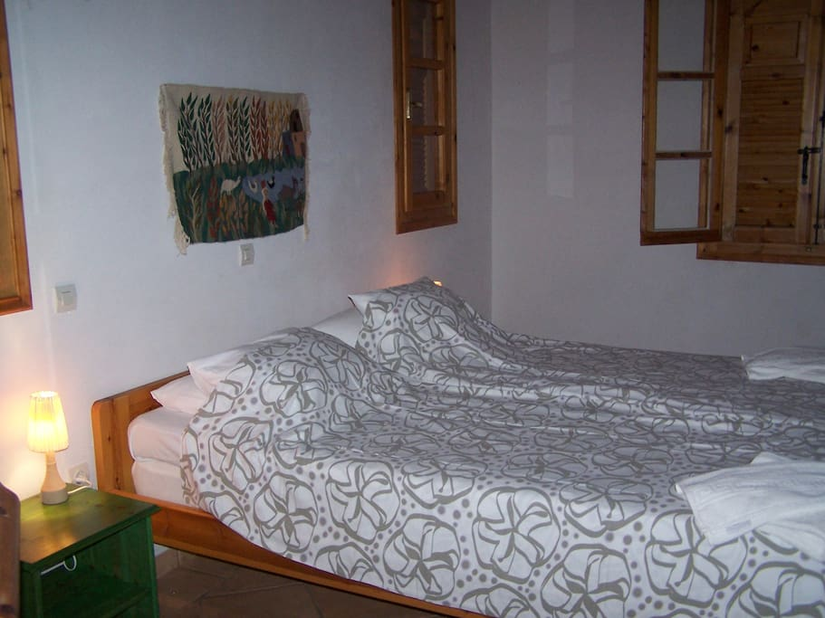 The double bed is 160x200cm and has IKEA memory foam mattress. there is enough space for both a cot and an extra bed.