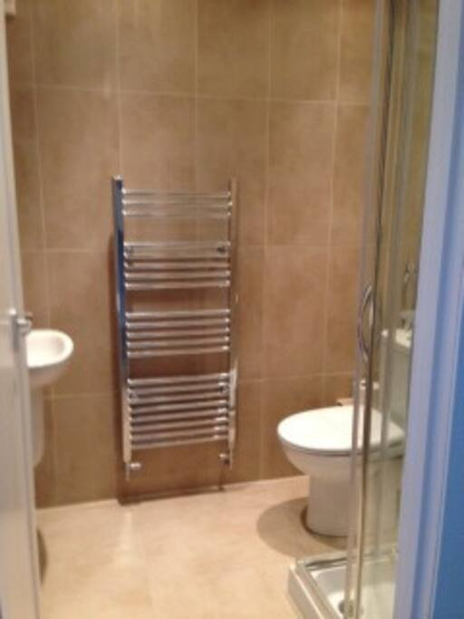 The fully tiled shower washroom is just next to your bedroom.