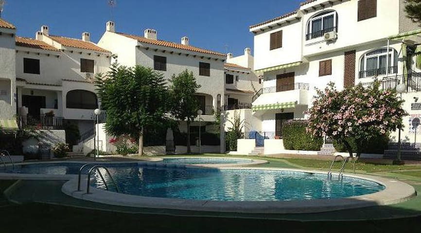 Holiday apartment with communal pool, in a great location
