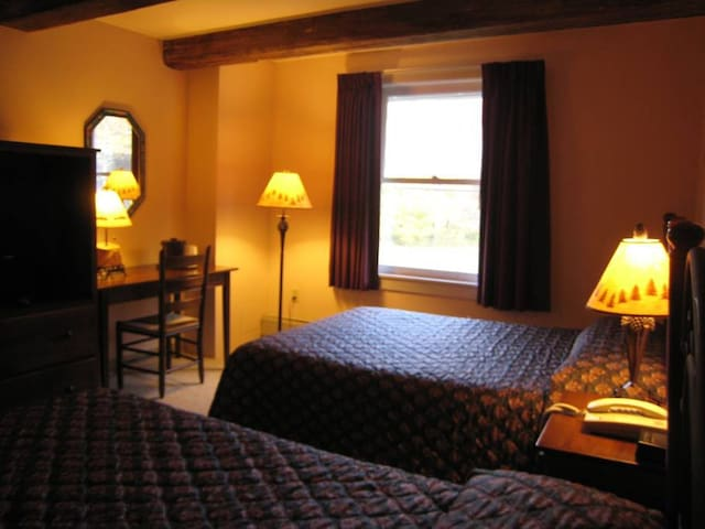 Room with two double beds and private bath 1/2 mile from the Sugarbush Resort at the historic Sugar Lodge.