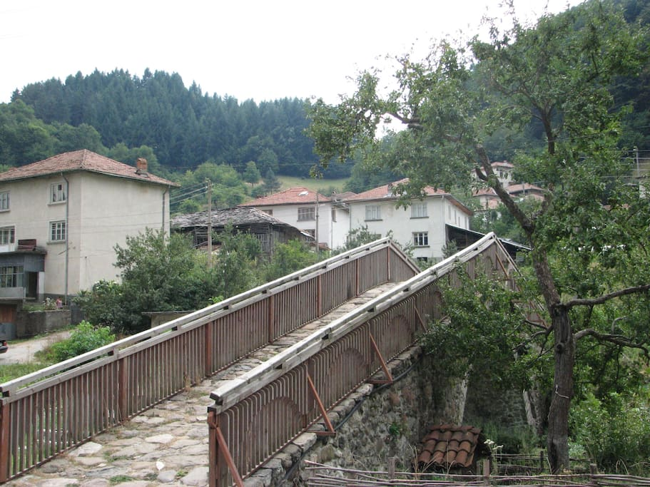 The old roman bridge in front of house
