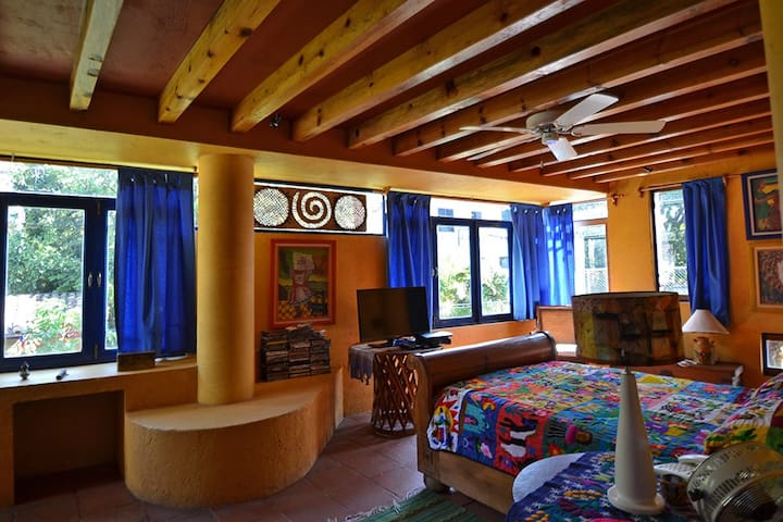 Master bedroom with living area, balcony and full bath