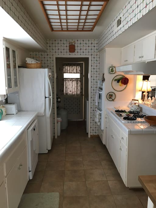 fully stocked kitchen and inside laundry space near back door