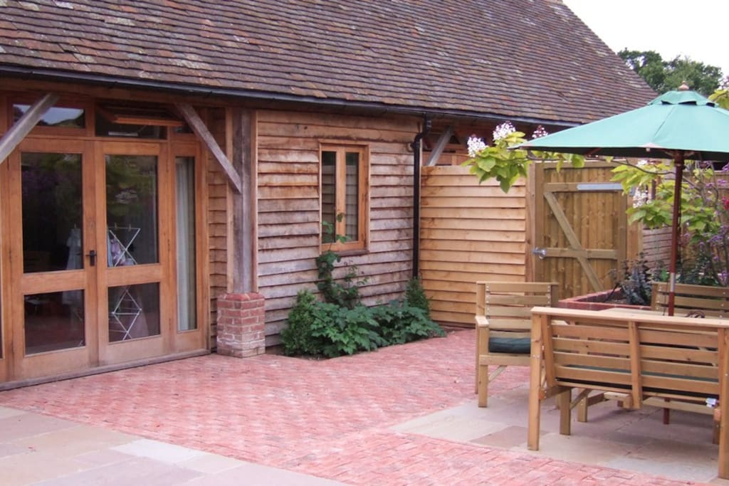Private walled courtyard with garden furniture