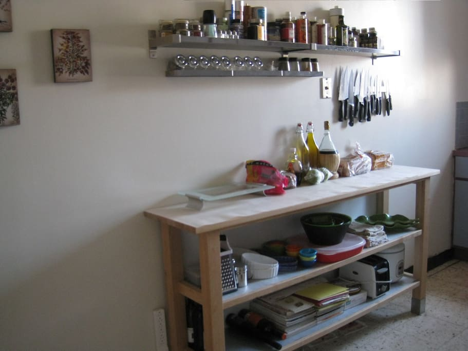 Kitchen Storage with floating spice rack and magnetic knife