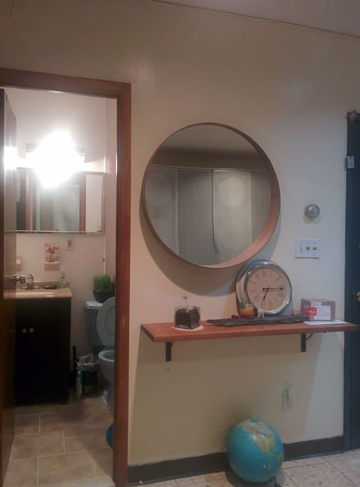 Console shelf with mirror before leaving the apartment