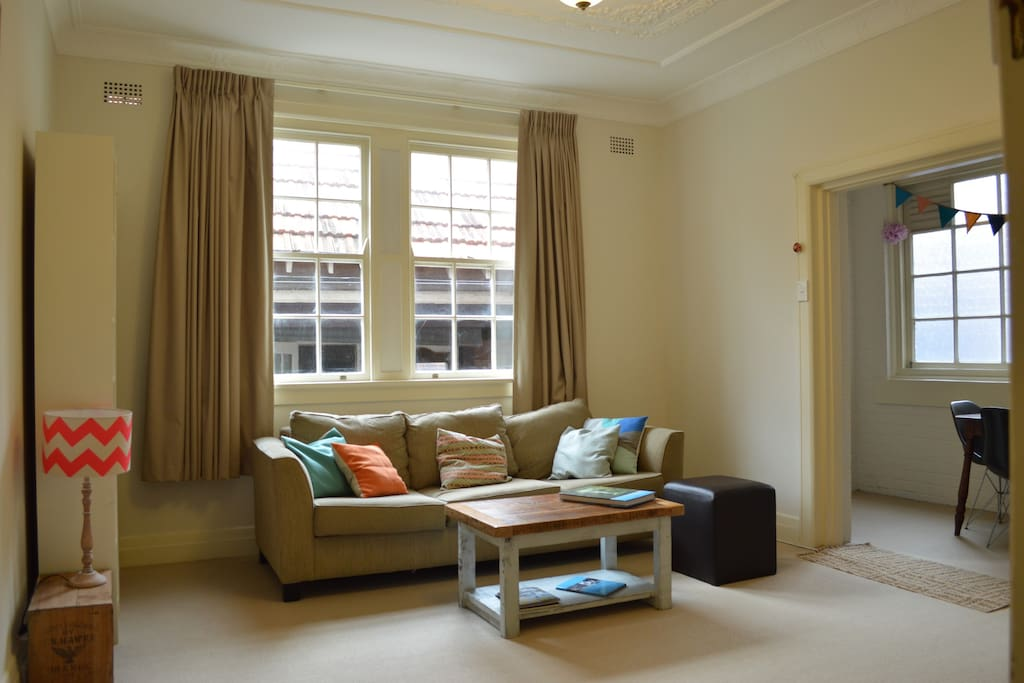 Spacious and cosy loungeroom, lots of natural light, separate dining area