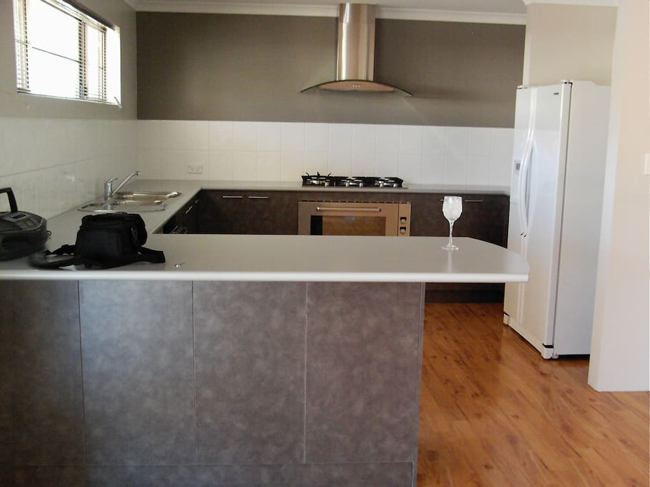 Kitchen - Large and open with breakfast bar.