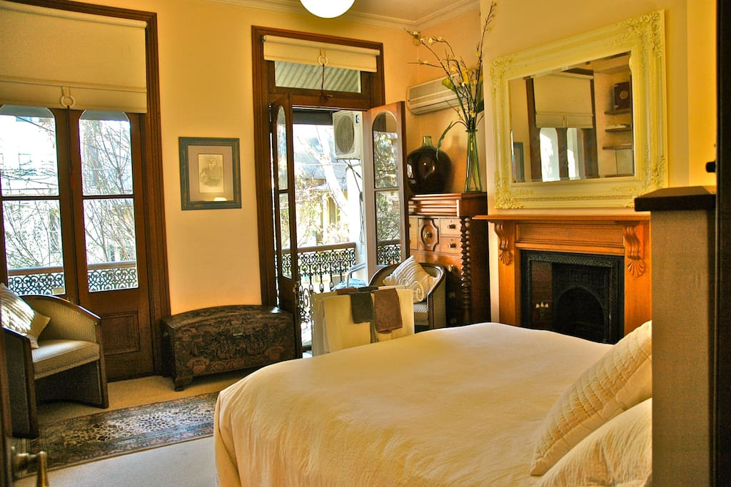 Your beautiful bedroom with double French doors to a sunny balcony overlooking the street.