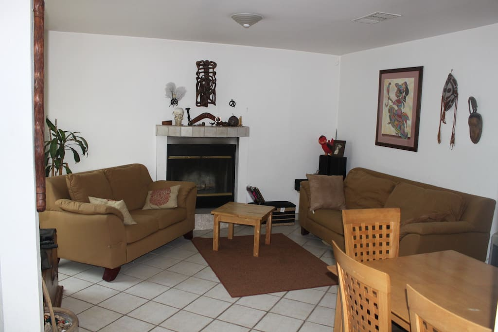 Living room with fireplace. TV w/dish network.