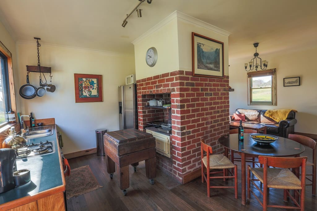 kitchen fireplace with Canberra wood stove and old butchers block
