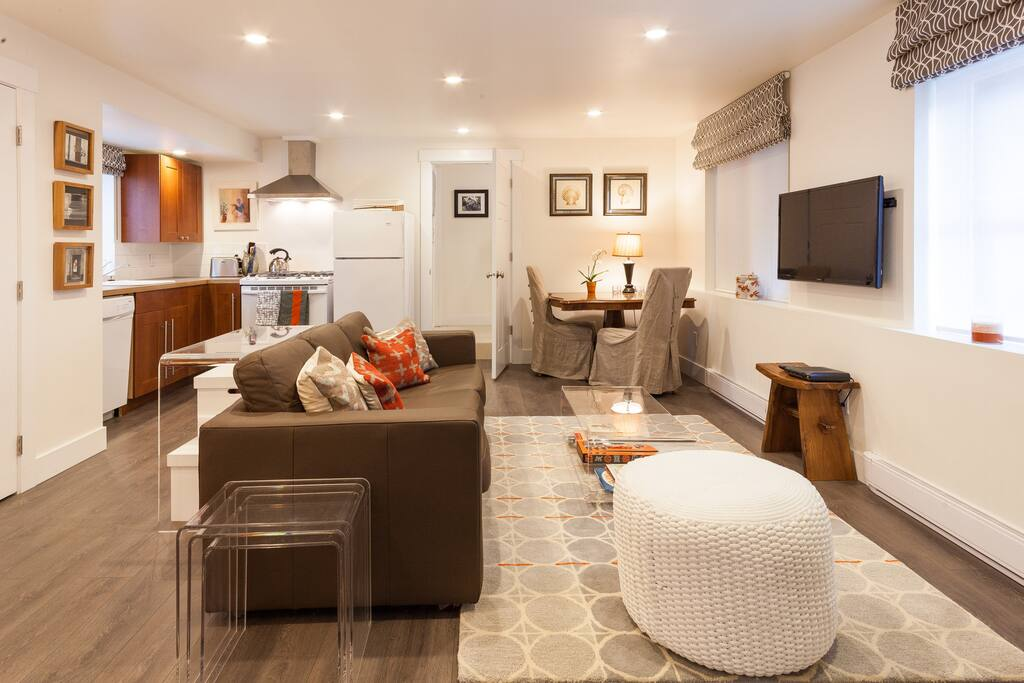 Neutral tones with orange accents make this both a very comfortable, functional and bright space