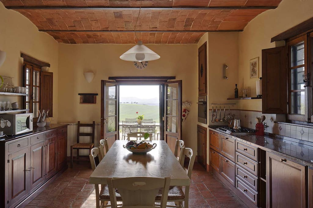 The spacious, fully equipped kitchen has a utility room to one side and a south facing terrace