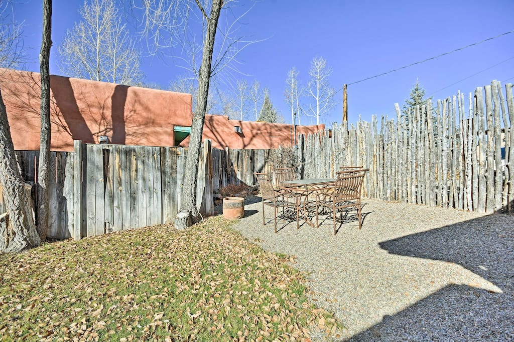 The property is completely fenced in, with seating for dining al fresco!