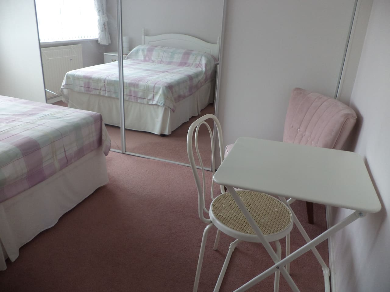 Bright double room with fitted wardrobes, armchair, desk and chair