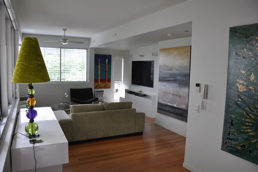Lounge room with seating for 6 people.  65 inch flat screen TV with integrated BOSE Lifestyle sound