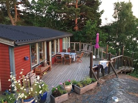 Talo yksityisellä rannalla, soutuvene,lautta ja sauna