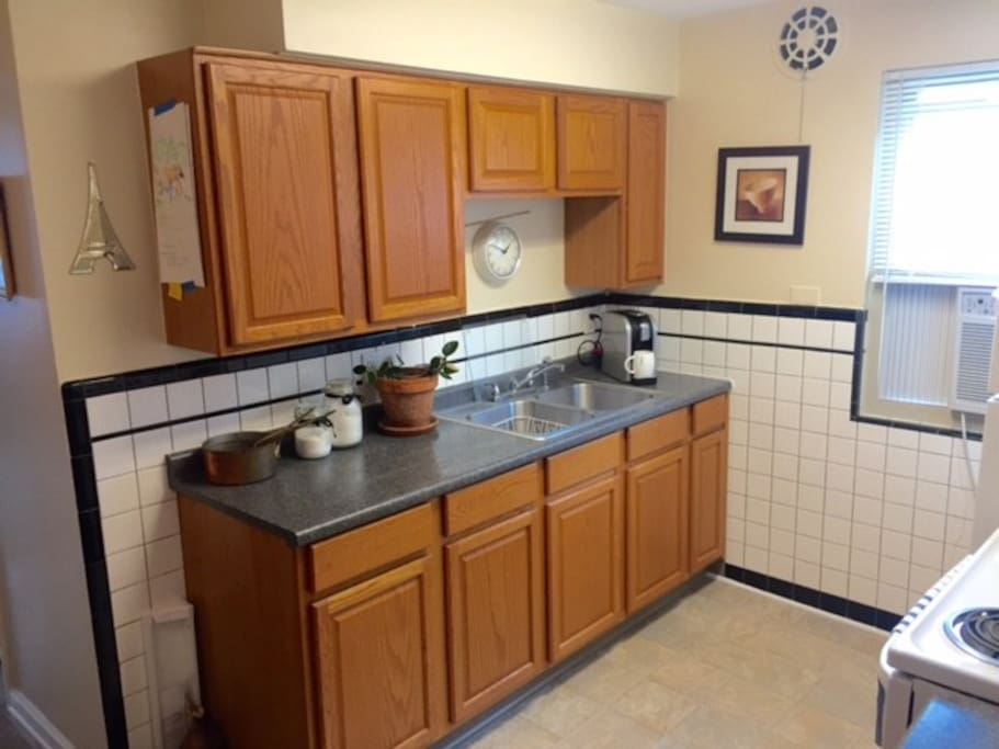 Great functional kitchen! Stove, microwave, and refrigerator included.