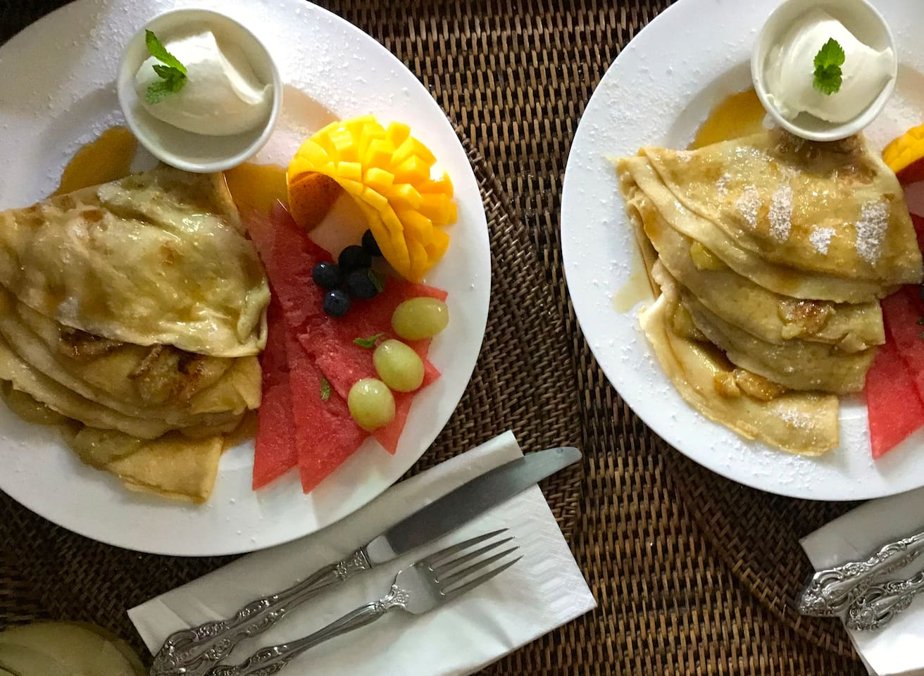 Selection of Crepes with caramelised banana, vanilla yoghurt, seasonal fruit & maple syrup. A cooked breakfast of local free range eggs, bacon, tomato, mushroom & sough dough bread, or home made bircher muesli & fresh fruit, ordered in house,