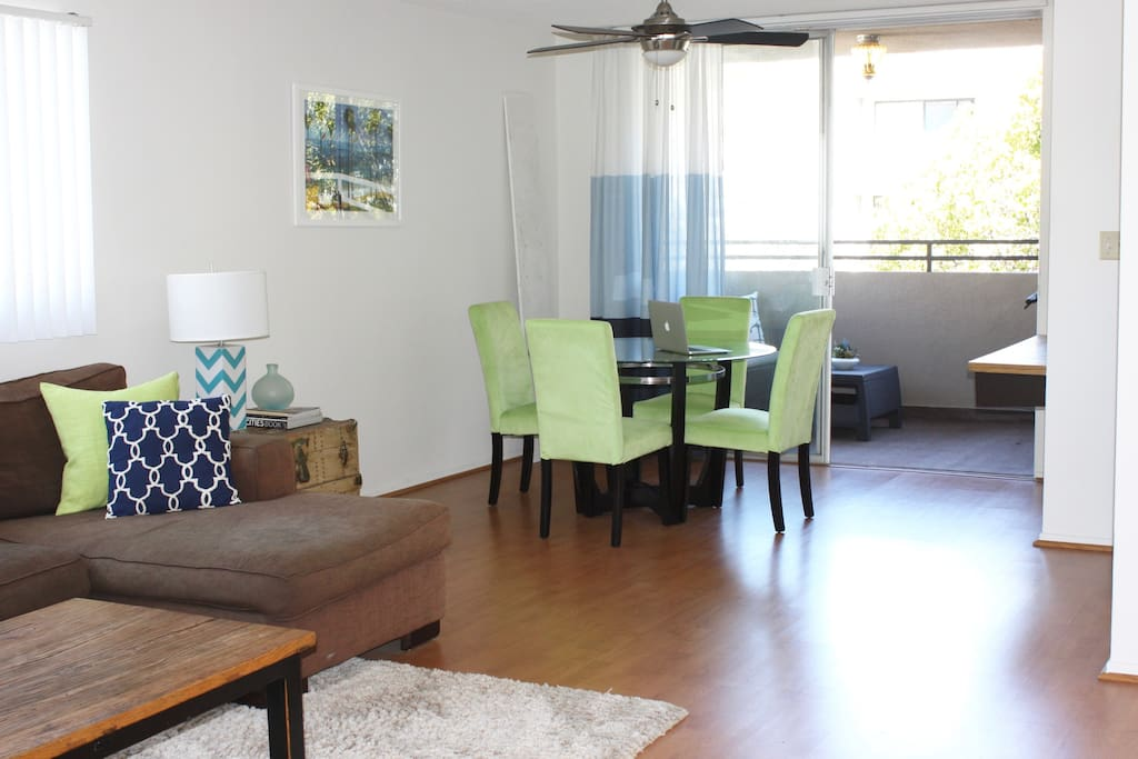 "Roomy living area to relax or work in with a 50"" TV (Netflix, Hulu Plus, PS4) and dining table."